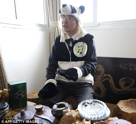 Unusual brew: Chinese entrepreneur An Yanshi (pictured in suitable attire) has turned panda poo into tea that costs a staggering £22,000 per pound