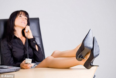 Bad for your health: Sitting at a desk all day can increase the risk of diabetes, heart attacks and strokes