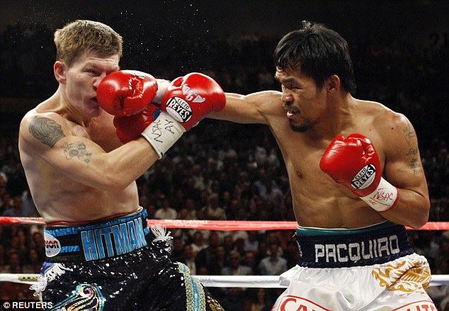 Manny Pacquiao lands a punch on Ricky Hatton during his victory over the Brit in 2009