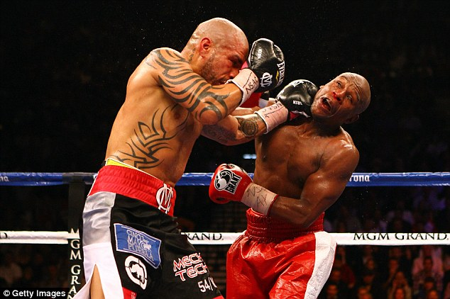 Mayweather (right) won a unanimous decision over Cotto in his only fight of 2012