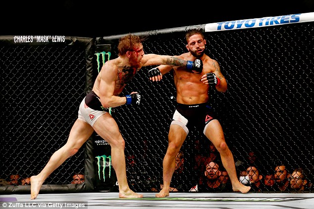 Chad Mendes (right) earned $500,000 dollars despite losing to McGregor as a late replacement last year