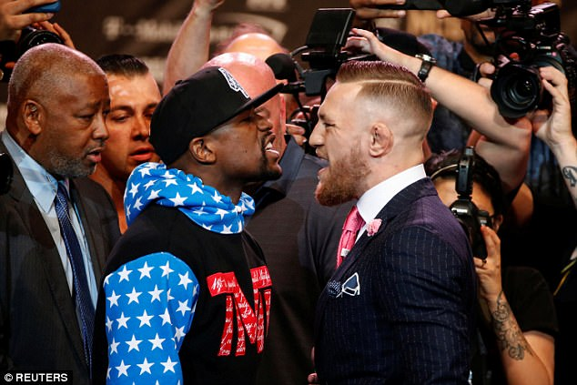 Floyd Mayweather (left) and Conor McGregor trade insults during their first staredown