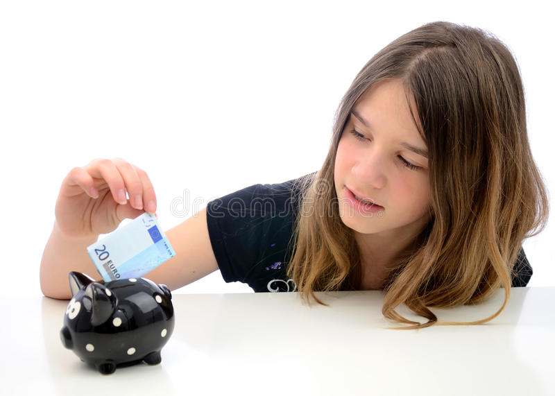 Euro money savings for teenager. Portrait of teenager saving twenty euro in piggybank stock image