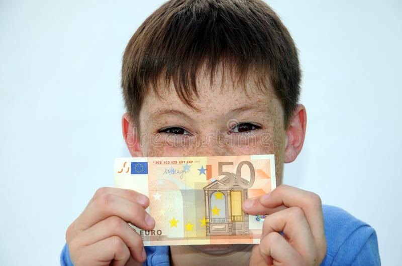 Pocket money. Happy teenager boy, he gets more pocket money stock photo