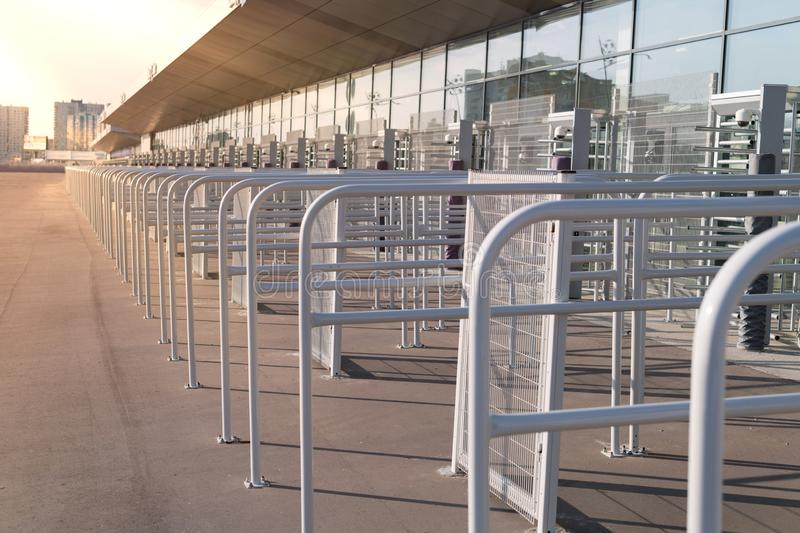 Security entrance gate - secured turnstiles before inspection at stadium royalty free stock photos