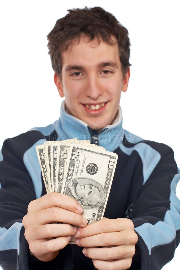 Showing a fan money. Handsome teenager showing a fan money. Focus on money royalty free stock image