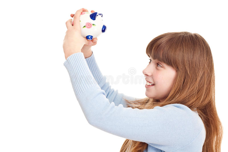 Teenager holding piggybank. Close up, teenager holding piggybank, isolated on white royalty free stock photos