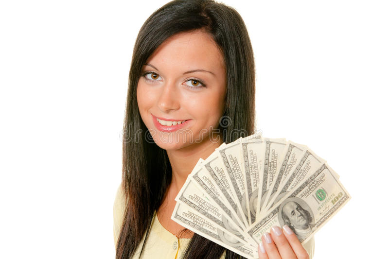 Teenager with wad of dollars. Smiling female teenager holding wad of dollar bill banknotes in fan shape, isolated on white background stock photo