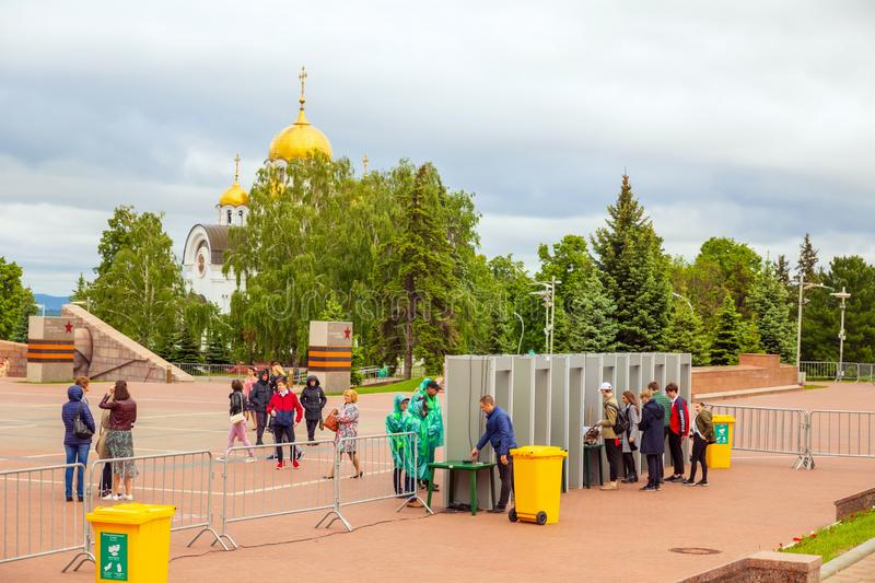 Turnstiles with arched frame metal detectors and security officers. Turnstiles with security officers on the Glory Square in Samara during the last call for royalty free stock photo