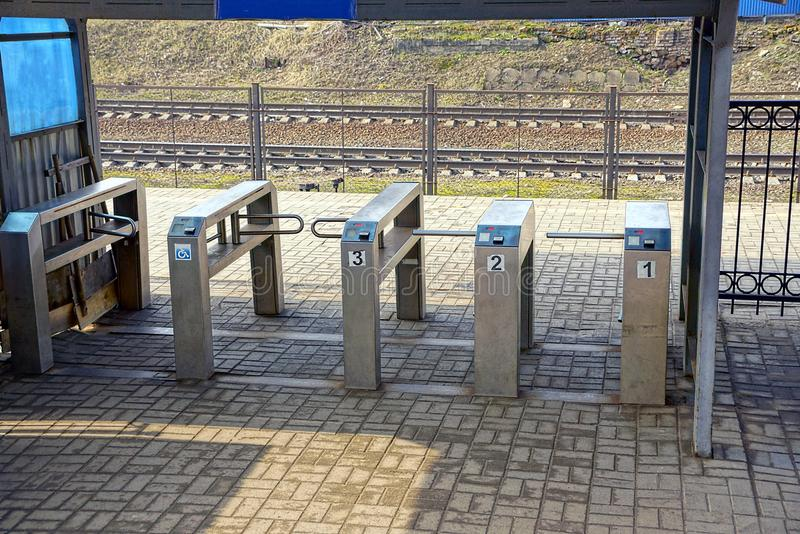Turnstiles at the railway station. Check point to the station from the iron turnstiles royalty free stock photography