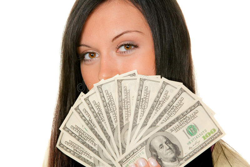 Wealthy teenager. With wad of dollar bills in front of face, isolated on white background stock images