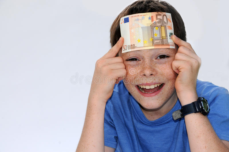 Wow, now I`m a rich boy. Happy teenager boy, he gets more pocket money stock photo