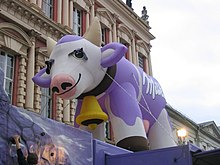 Large, inflated, purple Milka cow